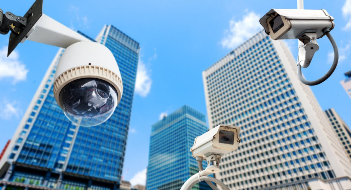 CCTV Camera or surveillance oeprating with building in background